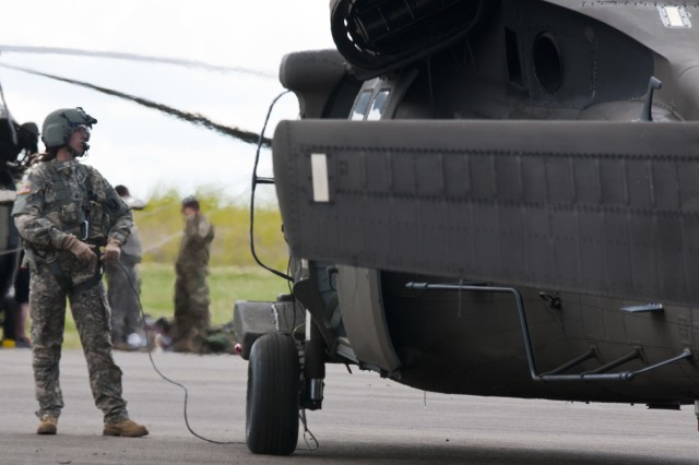 Sgt. Rebecca Himmel, a medic attached to the 1-169th Aviation Regiment, prepares to board a Black Hawk helicopter to perform a joint medevac training mission during Exercise Maple Resolve 17 at Camp Wainwright, Alberta, on May 16, 2017. Exercise Maple Resolve is an annual collective training event designed for any  contingency operation. Approximately 4,000 Canadian and 1,000 U.S. troops are participating in Exercise Maple Resolve 17.