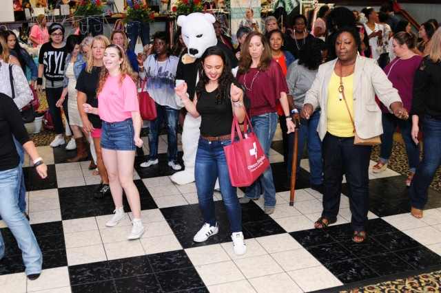 Ladies get down on the dance floor with Sgt. Ted E. Bear during Girls Night Out at The Landing May 12.