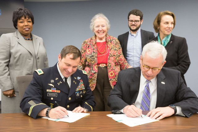 Joint Base Myer-Henderson Hall Commander Col. Patrick M. Duggan (front left) and Northern Virginia Regional Commission Executive Director Robert W. Lazaro, Jr., sign a Memorandum of Understanding for Commuter Services amongst JBM-HH, NVRC and Arlington Transportation Partners at the NVRC offices in Fairfax, Va., May 11. Also pictured, from left, are Donna Maxey, JBM-HH Plans, Analysis and Integration director; Penny Gross, chair, Fairfax County Board of Supervisors; Jonathan Bollhoefer, business development manager, Arlington Transportation Partners; and Libby Garvey, Arlington County Board member.