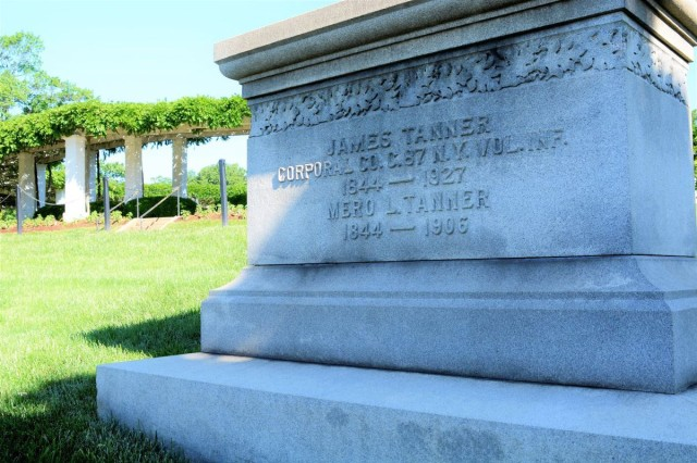 The grave of Cpl. James Tanner rests on a hisllside in Section 2 of Arlington National Cemetery. His burial site and close to a half dozen additional points of interest will be featured on the cemetery's latest history guided tour May 21. the amphitheater, named after Tanner is on the tour and is visible in the background.