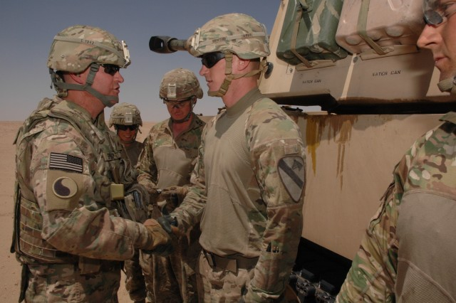 Brig. Gen. John Epperly, the deputy commander of Task Force Spartan, visits Soldiers from the 2nd Battalion, 82nd Field Artillery Regiment May 14, 2017, as they conduct Gunnery Tables at Camp Buehring, Kuwait as part of an Operation Spartan Shield. (U.S. Army Photo by Master Sgt. Sean McCollum, 29th Infantry Division)