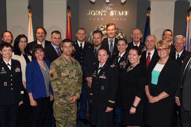 Recipients of Lean Six Sigma excellence awards from 11 organizations across the Army pose after being recognized by Karl Schneider (center), the senior career official performing the duties of the under secretary of the Army and Lt. Gen. Edward C. Cardon, director of the Office of Business Transformation, May 18, 2017.