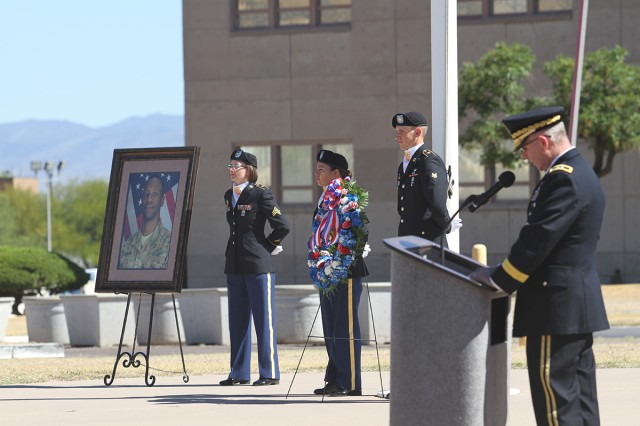 Members of the NETCOM Honor Guard stand guard by a memorial wreath and an image of Sgt. 1st Class Allan E. Brown while NETCOM Commanding General, Maj. Gen. John Baker, speaks during a ceremony rededicating the NETCOM Signal Cove of Remembrance, May 17, in front of the NETCOM headquarters, Greely Hall, Fort Huachuca, Ariz.  Brown, who was enshrined in the Cove, died Dec. 6 from wounds suffered a month earlier during an attack on Bagram Air Base, Afghanistan.  Brown was assigned to the 1st Cavalry Division, Fort Hood, Texas.