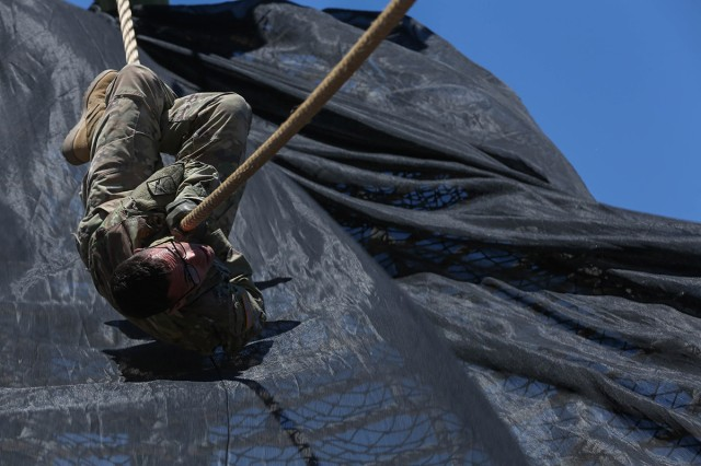 Spc. Stephen Calderone, assigned to the 160th Signal Brigade, U.S. Army Signal Activity-Kuwait, pulls himself along a rope at Fort Huachuca, Arizona, May 15, 2017, during the Network Enterprise Command (NETCOM) Best Warrior Competition. Calderone topped the other competitors in the Soldier category and was selected as the Soldier of the Year.