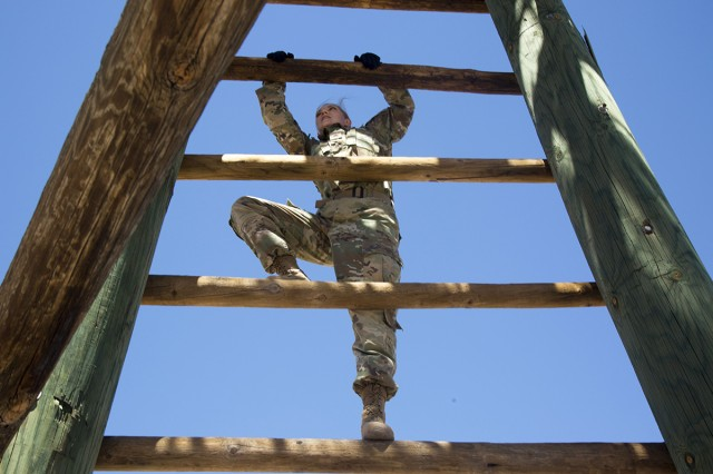 Sgt. Allison C. Sardler, assigned to 52nd Signal Battalion, 5th Signal Command (Theater), climbs a ladder during the obstacle course event of the 2017 NETCOM Best Warrior Competition at Fort Huachuca, Arizona, May 15, 2017. The competition is a grueling week-long event that tests the skills, knowledge, and professionalism of 11 Soldiers representing NETCOM's subordinate organizations.