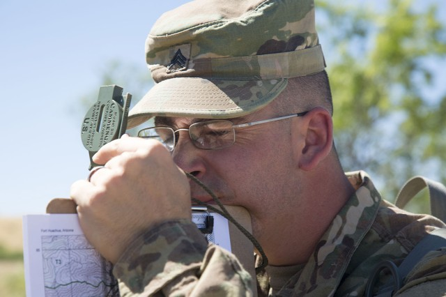 Sgt. Angel L. Ortiz, assigned to the U.S. Army Network Enterprise Center (USANEC), 160th Signal Brigade at Camp Arifjan, Kuwait, uses a compass during the land navigation event for the 2017 NETCOM Best Warrior competition at Fort Huachuca, Arizona, May 15, 2017. The competition is a grueling week-long event that tests the skills, knowledge, and professionalism of 11 Soldiers representing NETCOM's subordinate organizations.