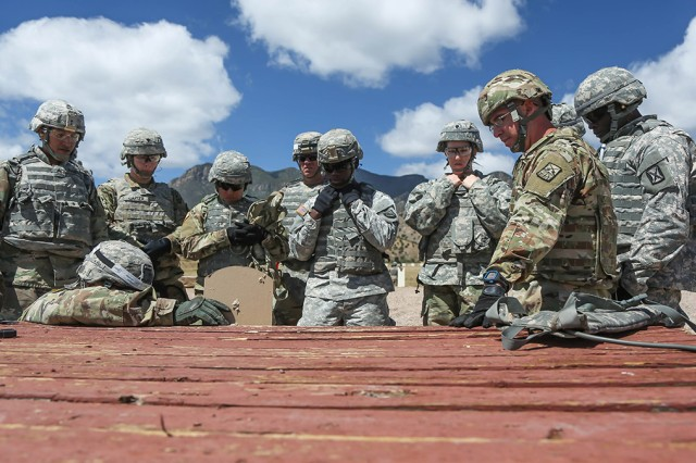 Soldiers competing in the 2017 Network Enterprise Technology Command (NETCOM) Best Warrior Competition receive instructions before qualifying with the M4 carbine at Fort Huachuca, Arizona, May 16, 2017. The M4 carbine qualification shoot is designed test competitors' marksmanship skills from the prone supported, prone unsupported and kneeling firing positions.