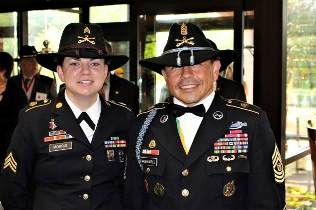 1st Squadron 2nd Cavalry Regiment's Command Sgt. Maj. Jerry Manzanares and Sgt. Sara Morris of Headquarters and Headquarters Troop, 1st Squadron, 2d Cavalry Regiment at the formal Dining In at the 2CR's reunion in Williamsburg, Virginia, April 27-30, 2017.