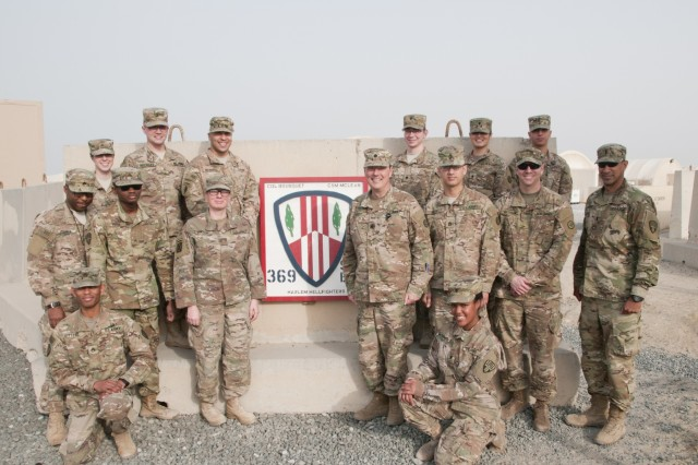 Intelligence analysts and officers of the 369th Sustainment Brigade and 1st Sustainment Command (Theater) Operational Command Post pose for a photo prior to their weekly intelligence sharing meeting at Camp Arifjan, Kuwait, March 3, 2017. Intelligence analyst are responsible for the analysis, processing and distribution of strategic and tactical intelligence.