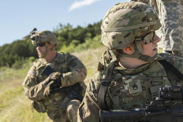 Staff Sgt. Heidi Stotler and Sgt. 1st Class Matt Howard practice tactical team movement techniques at Fort Hood, Texas, May 4.