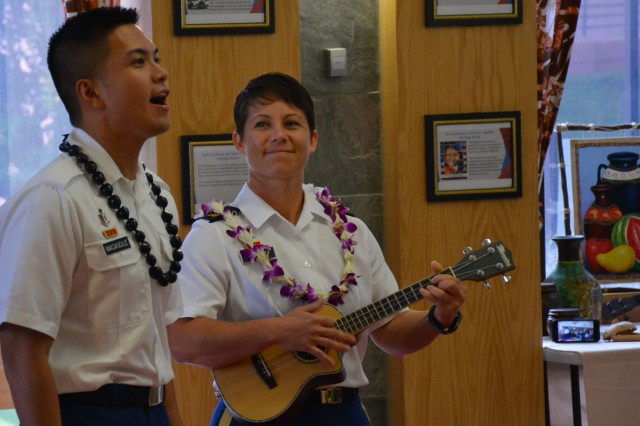 Spc. Jankenneth L. Macandile sings the national anthem accompanied by Sgt. Crystalen P. Lopez playing the ukulele during the Asian American Pacific Islander Heritage Month observance on Friday, May 19th at Tripler Army Medical Center.