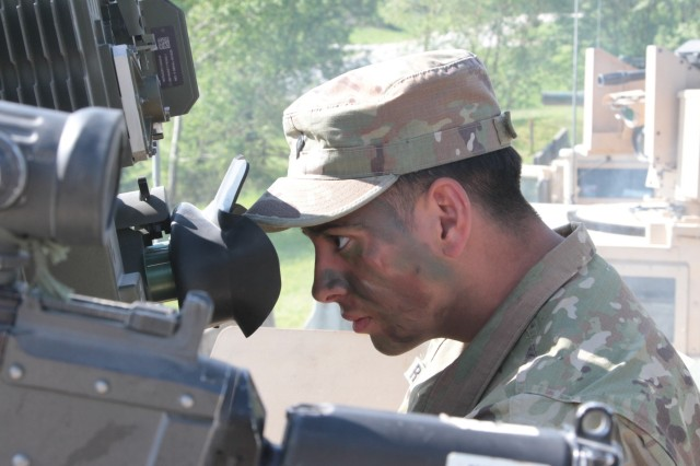 Spc. Adrian Rodriguez of 2nd Platoon, Company D, 2nd Battalion, 12th Infantry Regiment, 2nd Infantry Brigade Combat Team, 4th Infantry Division, calibrates the Improved Target Acquisition System, which engages enemy tanks, for the gunnery table exercise he's about to participate in on May 22, 2017 at Grafenwoehr Training Area, Germany. The gunnery table is one of the most important tests for the light infantryman, because it can offer challenges of teamwork and efficiency ranging from the single High Mobility Multipurpose Wheeled Vehicle (HMMWV) to company-level numbers of vehicles. (Photo taken by Pvt. Nicholas Vidro, 7th Mobile Public Affairs Detachment.)