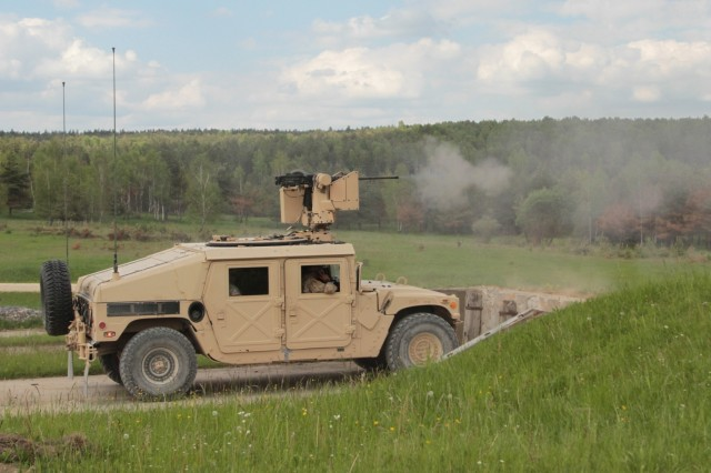 A High Mobility Multipurpose Wheeled Vehicle (HMMWV) from 2nd Platoon, Company D, 2nd Battalion, 12th Infantry Regiment, 2nd Infantry Brigade Combat Team, 4th Infantry Division, engages a target on the gunnery table range on May 22, 2017 at Grafenwoehr Training Area, Germany . The HMMWV is equipped with a Common Remotely Operated Weapon Station (CROWS) and is one of two HMMWVs tested during this gunnery table exercise, which examines the teamwork and effectiveness of both vehicle crews. (Photo taken by Pvt. Nicholas Vidro, 7th Mobile Public Affairs Detachment.)