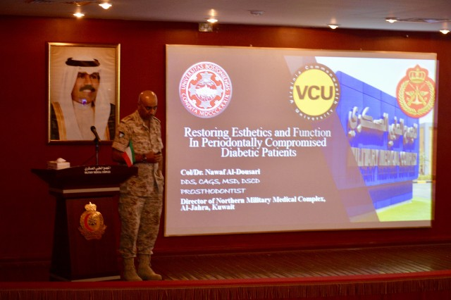 Col. Nawaf Al-Dousari, medical director of the Al-Jahra Military Hospital begins his presentation as part of a continuing education lecture series for medical professionals working at the Al-Jahra Military Hospital, May 11, 2017, Kuwait City.