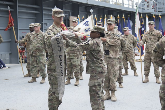 "Lt. Col. Lucas S. Hightower, commander of the 553rd Combat Sustainment Support Battalion, and Command Sgt. Maj. Antheena Felton, senior enlisted advisor of the 553rd CSSB, case the battalion's colors during a transfer of authority ceremony on Logistics Support Vehicle - 6 (LSV-6) ""Spc. James A. Loux"" at Kuwait Naval Base, on April 17, 2017. The 553rd CSSB, from Ft. Hood, Texas, is being replaced by the 548th CSSB from Ft. Drum, N.Y. (U.S. Army photo by Sgt. Cesar E. Leon)"