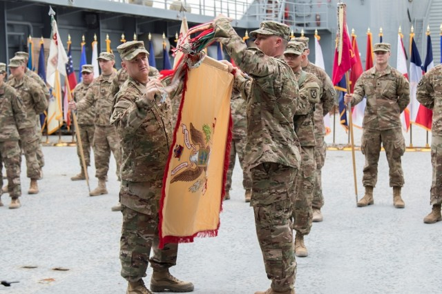 "U.S. Army Lt. Col. Douglas C. Thompson, Commander of the 548th Combat Sustainment Support Battalion, and Master Sgt. Benjamin Brink, senior enlisted advisor of the 548th CSSB, uncase the battalion's colors during a transfer of authority ceremony on Logistics Support Vehicle - 6 (LSV-6) ""Spc. James A. Loux"" at Kuwait Naval Base, on April 17, 2017. The 548th CSSB from Ft. Drum, N.Y., assumed mission command from the 553rd CSSB from Ft. Hood, Texas. (U.S. Army photo by Sgt. Cesar E. Leon)"
