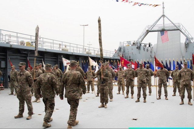 "U.S. Army Soldiers from the 553rd CSSB and 548th CSSB participate in the transfer of authority ceremony on April 17, 2017 on board Logistics Support Vehicle - 6 (LSV-6) ""Spc. James A. Loux."" This ceremony marked the passing of command from the 553rd CSSB to the 548th CSSB in Kuwait. (U.S. Army photo by Sgt. Cesar E. Leon)"