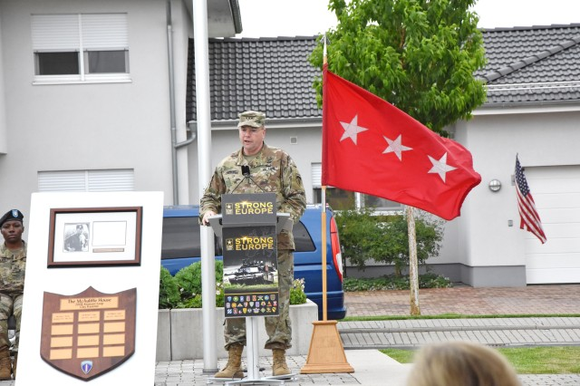 WIESBADEN, Germany -- Lt. Gen. Ben Hodges, U.S. Army Europe commanding general, speaks at a dedication ceremony May 19 in Newman Village. A field and the surrounding five homes were named in honor of Soldiers who served in Europe.