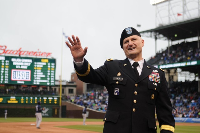 "Maj. Gen. Ed Daly, senior commander of Rock Island Arsenal and commanding general, U.S. Army Sustainment Command, throws out the first pitch at the Chicago Cubs versus Milwaukee Brewers game May 19. The event, as part of the ""Meet Your Army"" initiative, is meant to bring senior military leaders to large population hubs to foster an environment of civilian understanding of the military."