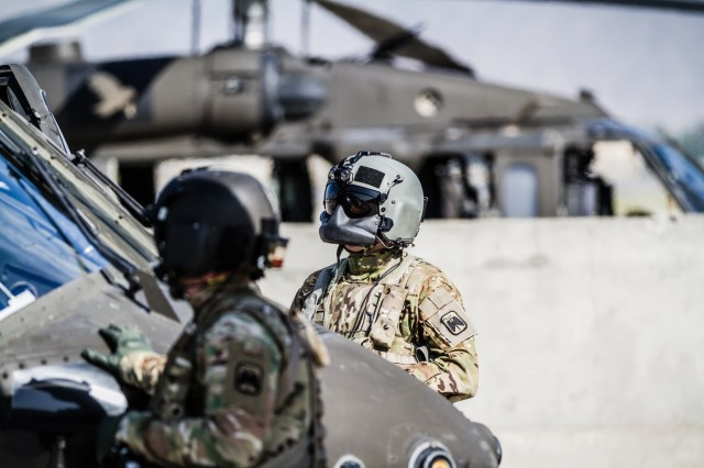 U.S. Army UH-60 Black Hawk helicopter crew chiefs assigned to Task Force Tigershark, 16th Combat Aviation Brigade, 7th Infantry Division prepare for a mission at Operating Base Fenty in Jalalabad, Afghanistan, May 17, 2017. The Tigersharks are working hard to support U.S. Forces Afghanistan as part of Operation Freedom's Sentinel and Resolute Support Mission.