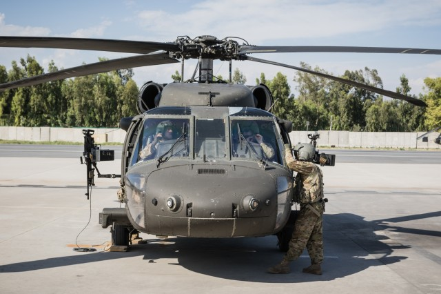 A U.S. Army UH-60 Black Hawk helicopter crew assigned to Task Force Tigershark, 16th Combat Aviation Brigade, 7th Infantry Division prepares for a mission at Operating Base Fenty in Jalalabad, Afghanistan, May 17, 2017. The Tigersharks are working hard to support U.S. Forces Afghanistan as part of Operation Freedom's Sentinel and Resolute Support Mission.