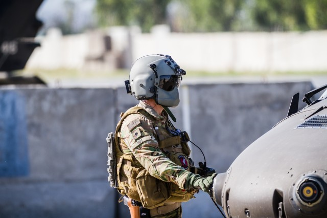 A U.S. Army UH-60 Black Hawk helicopter crew chief assigned to Task Force Tigershark, 16th Combat Aviation Brigade, 7th Infantry Division prepares for a mission at Operating Base Fenty in Jalalabad, Afghanistan, May 17, 2017. The Tigersharks are working hard to support U.S. Forces Afghanistan as part of Operation Freedom's Sentinel and Resolute Support Mission.