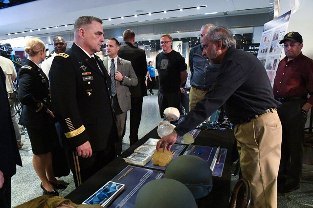 Chief of Staff Gen. Mark A. Milley receives a short explanation about Gelman Surrogate for Armor Design and Injury Assessment currently in development by the U.S. Naval Research Laboratory at the Military Invention Day held at the Smithsonian National Museum of American History, May 20, 2017.