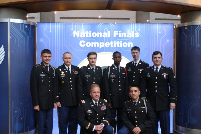 The Leilehua High School CyberPatriot team, their coach and mentors: Standing (from left to right), Cadet Tyler McWilliams, Chief Warrant Officer 3 Lee Unrein, Cadet Brandon Unrein, Cadet Jarod Olive-Stalling, Spc. Jacob Cochran, and Spc. Evan Wittman. Kneeling are retired Army Lt. Col. Nick Spiridigliozzi (left), the teams coach and JROTC senior instructor, and Cadet Jacob Huerta (right).  McWilliams, Huerta and Unrein aspire to be cyber defense professionals for the National Security Agency, and Olive-Stallings wants to be a Naval Officer after graduating from high school.  The three Soldiers are assigned to Detachment-Hawaii, 782nd Military Intelligence (MI) Battalion (Cyber), 780th MI Brigade (Cyber), based out of Schofield Barracks, Hawaii.