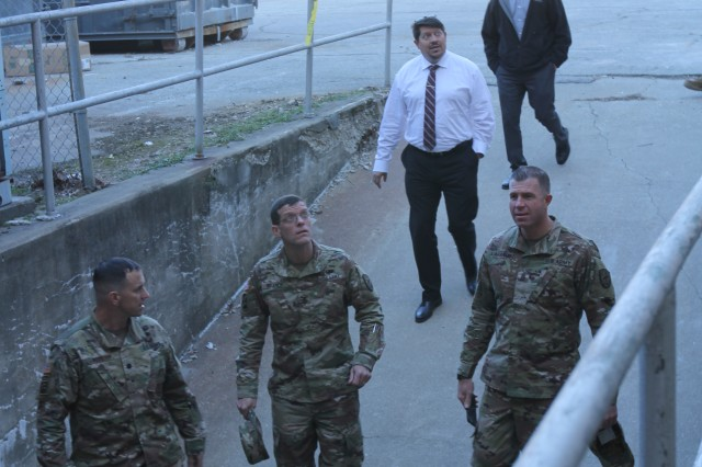 Lt. Col John Pitt (bottom left), commander of Muscatatuck Urban Training Center (MUTC), escorts Col. John (David) Branch, commander of 780th Military Intelligence Brigade (Cyber), and other brigade leaders on a tour of the various urban training zones, to include a multi-story hospital, fresh-water and waste-water treatment facilities, a coal-fired steam plant, an embassy, high school, and prison, at MUTC, Butlerville, Ind., Mar. 15.