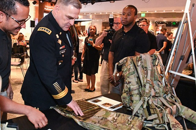 Chief of Staff Gen. Mark A. Milley receives a short explanation about dismounted Soldier power and the energy-harvesting technology currently in development by the U.S. Army Communication Electronics Research, Development and Engineering at the Military Invention Day held at the Smithsonian National Museum of American History, May 20, 2017.