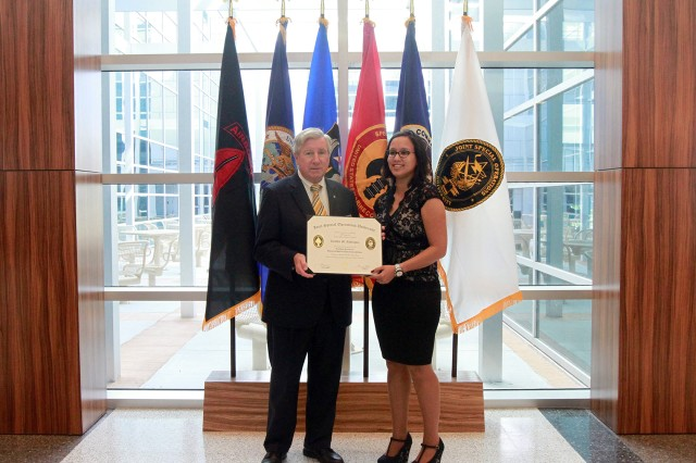 Cynthia Claridge, U.S. Army Special Operations Command, G-2 intel analyst, is the first in U.S. Army Special Operations Command Headquarters to graduate the Joint Special Operations University Master's Certificate program.