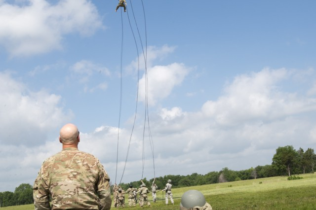Army and Air National Guardsmen from all over the nation rappel out of UH-60 Blackhawk helicopters on May 18, 2017, one of the culminating events before completing Air Assault school held at the Oklahoma National Guard's premier training area, Camp Gruber Training Center, near Braggs, Oklahoma.