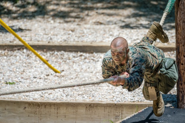 Joint Service Noncommissioned Officer of the Year, Marine Sgt. Cole Bumsted, crosses a one-rope bridge obstacle during the 2017 Best Warrior Competition at Fort Leonard Wood.