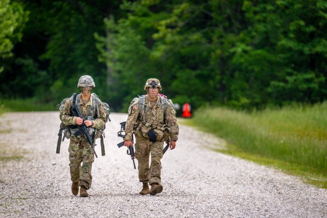 Two Soldiers in the MSCoE Best Warrior Competition ruck between stations on day three of the competition.