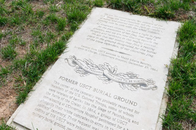 A plaque marks an area of Alexandria, Va.'s Contrabands and Freedmen Cemetery Memorial, once reserved for the burial of U.S. Colored Troops.