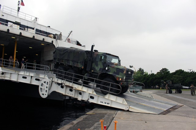 Marines back trucks onto the USNS Westpac Express for faster offload during port operations at Yokohama North Dock, Japan, on May 15.