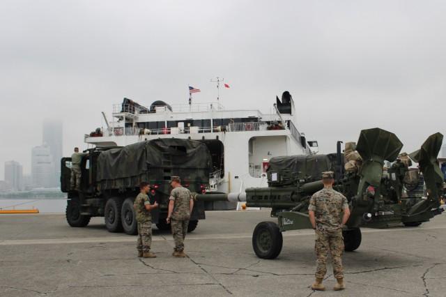 Marines upload cargo and equipment during port operations at Yokohama North Dock, Japan, on May 15.