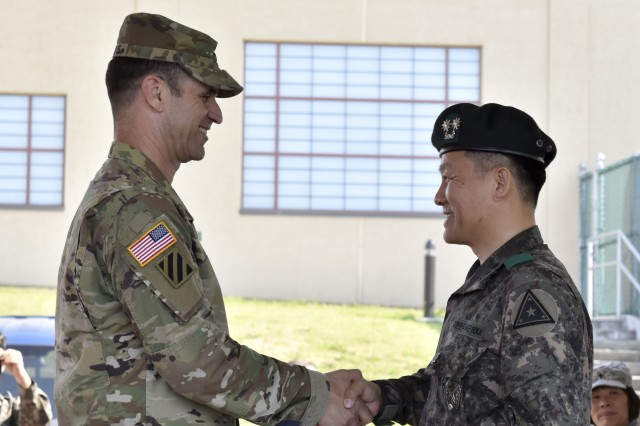 Col. Ted Stephens shakes hands with Lt. Col. Jung, Hyunwoong, Area IV ROKA Support Group commander, during the closing ceremony on May 18, 2017.