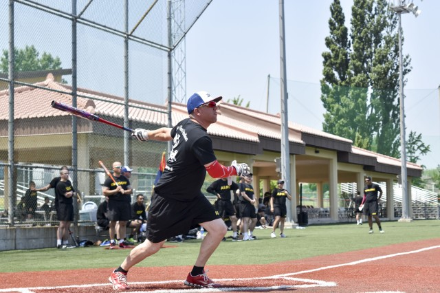 A Soldier assigned to the 2ID Sustainment Brigade hits the ball during the softball finals on May 18, 2017.