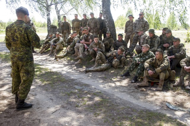 A Canadian soldier teaches a class to Ukrainian noncommissioned officers during Junior Leader Advanced Training at a Ukrainian army base near Zhytomyr, Ukraine, on May 22.U.S. Soldiers from the 45th Infantry Brigade Combat Team assigned to the Joint Multinational Training Group - Ukraine are working alongside Canadian troops to train Ukrainian noncommissioned officers in Zhytomyr before their battalion arrives at the Yavoriv Combat Training Center for a 55-day training rotation later this year. (Photo by Sgt. Anthony Jones, 45th Infantry Brigade Combat Team)