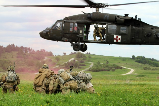 Grafenwoehr, Germany (May 22, 2017) -- Soldiers from 2nd Battalion, 12th Infantry Regiment (2-12 IN) conducts an air medical evacuation during a platoon-level Situational Training Exercise (STX) lane, here. Approximately 600 Soldiers from 2-12 IN, 2nd Infantry Brigade Comabat Team, 4th Infantry Division conducted platoon-level training at the Grafenwoehr Training Area in Bavaria, Germany, as part of an Emergency Deployment Readiness Exercise (EDRE). An EDRE is an opportunity to validate the unit's readiness to deploy world-wide on short notice, while testing the ability of U.S. Army Europe and subordinate units to receive, transport, feed, house and train units as they arrive in theater.