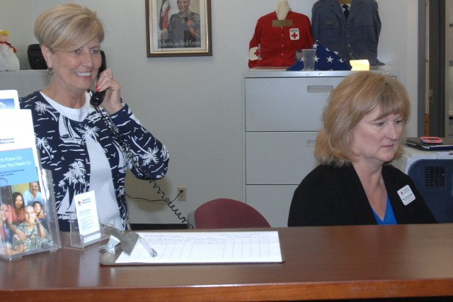 From left, Sandy Vaughn, from the St. Louis Red Cross office, and Mary Patrick Stewart, Fort Leonard Wood ARC, work in the new Red Cross office located in Building 470.