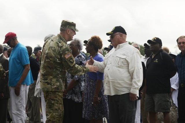 Fort Jackson Commander Maj. Gen. Pete Johnson shakes hands with Vietnam-era veterans during 2nd Battalion, 13th Infantry Regiment's graduation May 18 at Hilton Field as part of Retiree Appreciation Days.