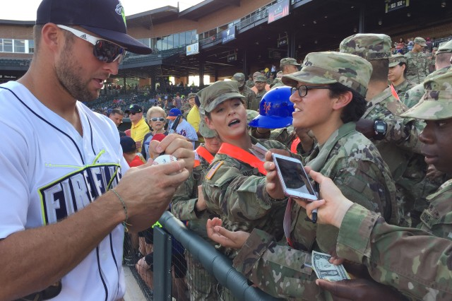 Columbia Fireflies outfielder Tim Tebow signs autographs for Fort Jackson Soldiers before the start of Saturday's Military Appreciation Night baseball game at Spirit Communications Park in Columbia, S.C.