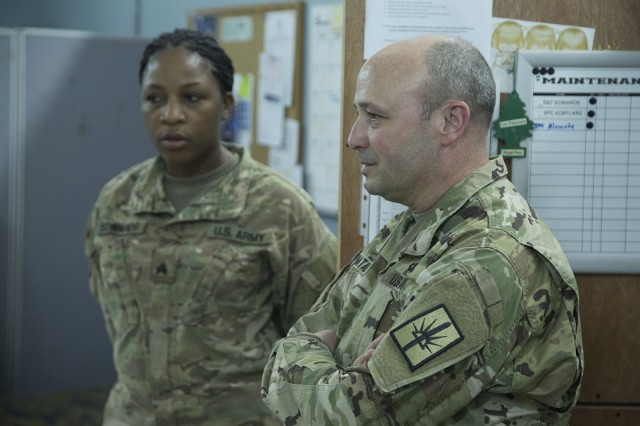 Brig. Gen. Michel Natali , the commander of the 53rd Troop Command, listens during a meeting with member of Headquarters Company, 369th Sustainment Brigade, during a visit to Camp Arifjan, Kuwait on May 17, 2017. Leaders of the New York National Guard visited New York Army National Guard Soldiers serving in Kuwait May 16-18, 2017.