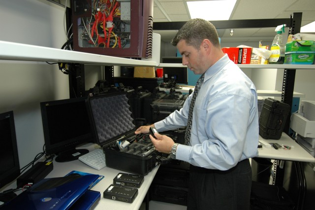 "An agent with the Army Criminal Investigation Command's Computer Crime Investigative Unit prepares gear as part of an investigation. With ongoing cases of ""sextortion"" occurring across the Army -- a cybercrime where someone threatens to expose a sexual image in order to gain money or something else from a victim -- Army investigators have issued a new warning to Soldiers so they don't fall prey to the crime."