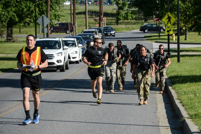 Soldiers with 704th Military Intelligence Brigade race to the next challenge during the Super Squad Competition May 18 at Fort Meade, Maryland. The competition pitted teams from the Army, Air Force, Marines and NSA police against one another in a race to complete challenges throughout Fort Meade.