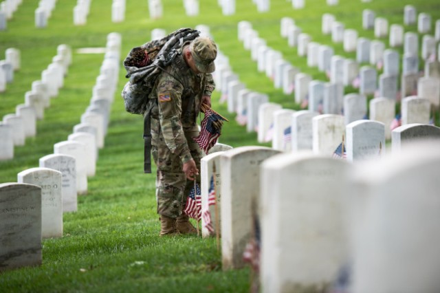 "Soldiers assigned to the 3rd U.S. Infantry Regiment (The Old Guard) participate in ""Flags-In"" at Arlington National Cemetery in Arlington, Va., May 25, 2017. During the event, The Old Guard honors America's fallen heroes by placing an American flag at each gravesite for service members buried at the cemetery."