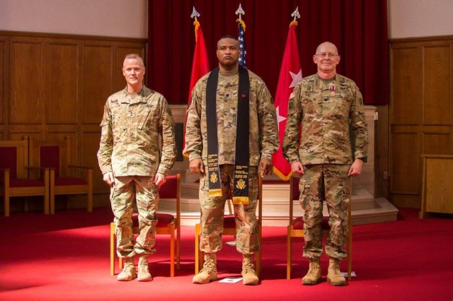 Lt. Col. Khallid Shabazz, center, participates in a Change of Stole ceremony inside the Lewis Main Chapel at Joint Base Lewis-McChord, Wash., May 23, 2017. Shabazz, the former I Corps deputy chaplain, became the chaplain for the 7th Infantry Division, making him the Army's first Islamic chaplain at the division level.