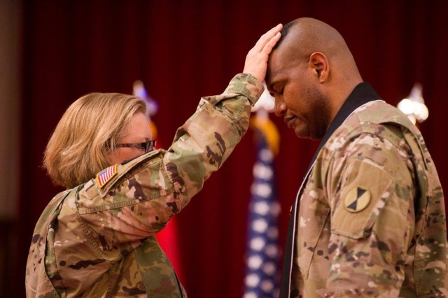 Lt. Col. Khallid Shabazz, right, participates in a Change of Stole ceremony inside the Lewis Main Chapel at Joint Base Lewis-McChord, Wash., May 23, 2017. Shabazz, the former I Corps deputy chaplain, became the chaplain for the 7th Infantry Division, making him the Army's first Islamic chaplain at the division level.
